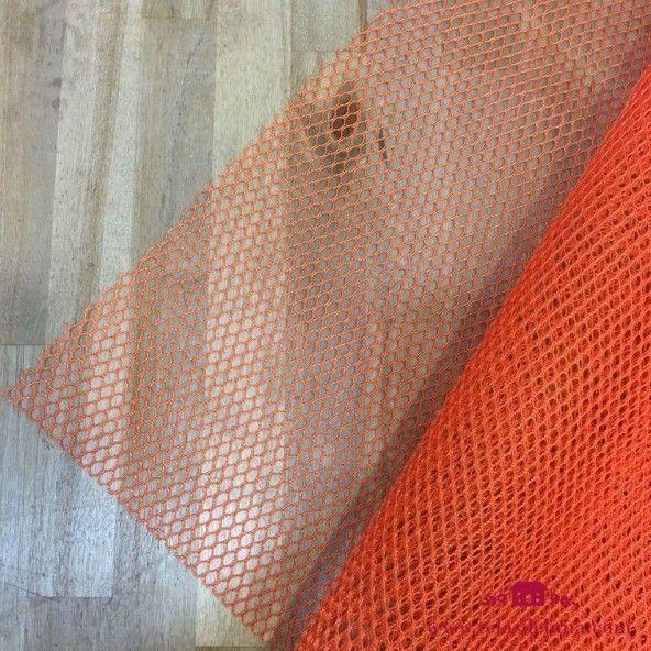 Tela de red naranja y cinta