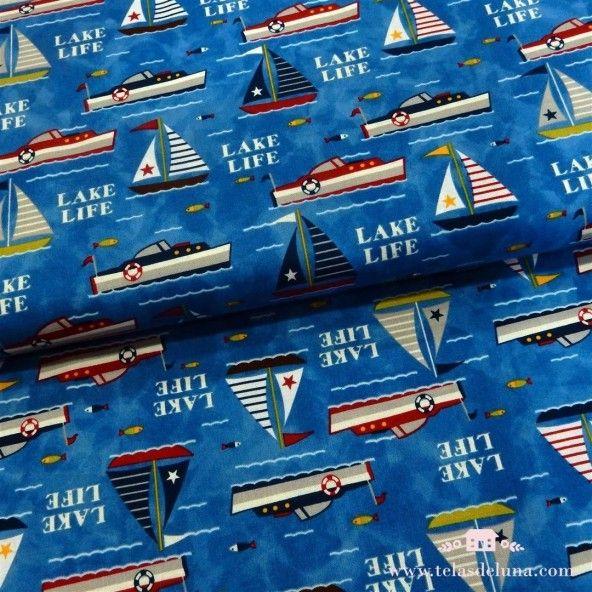 Tela marinera barcos fondo azul