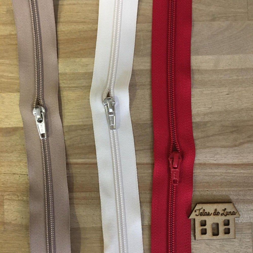 Cremalleras marron, blanca y roja