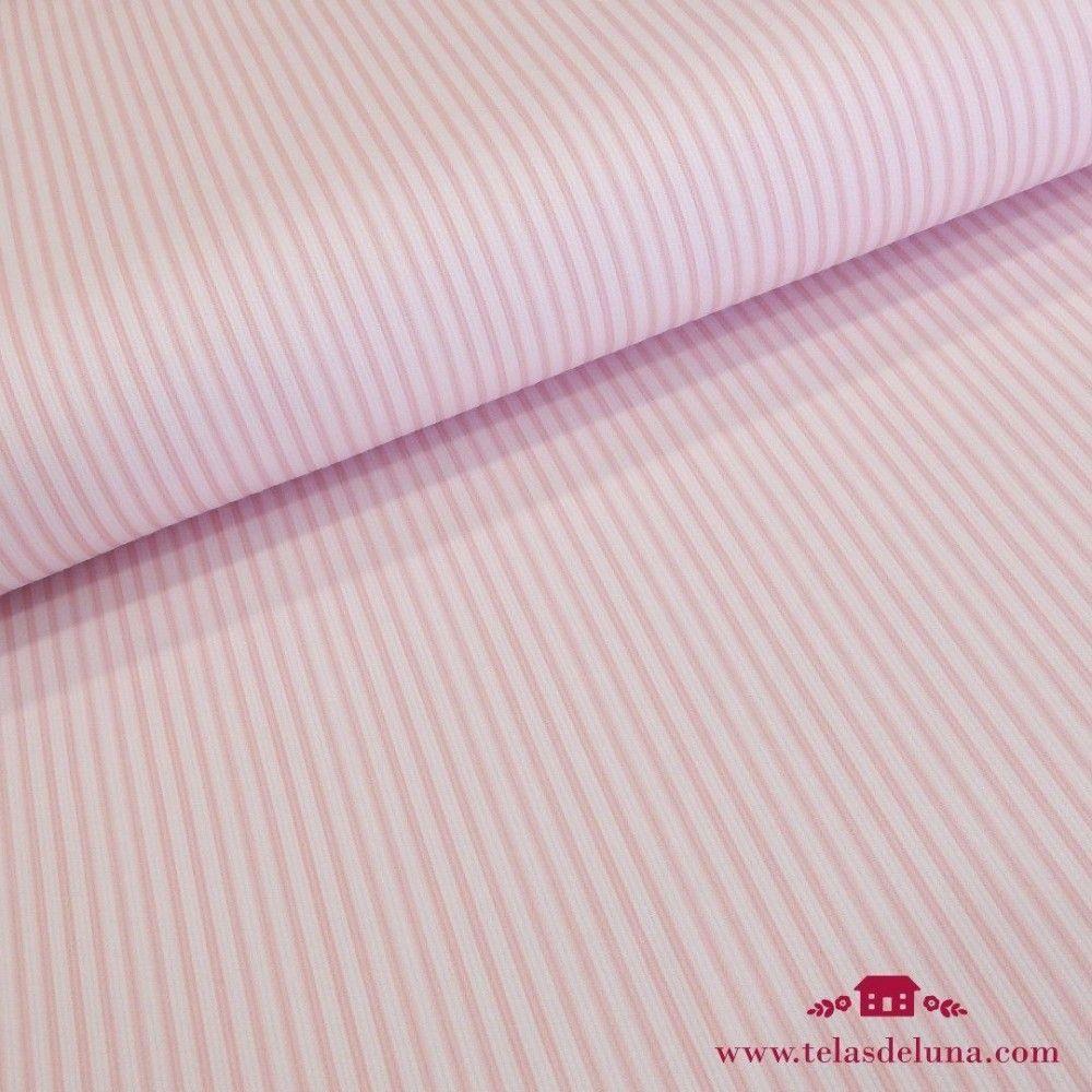 Tela piqué blanca topitos rosa