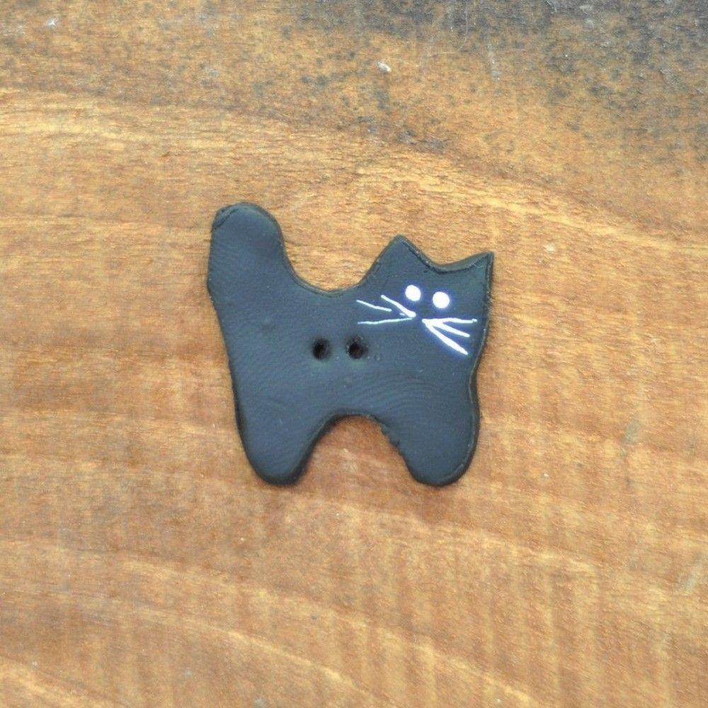 Botón decorativo gato