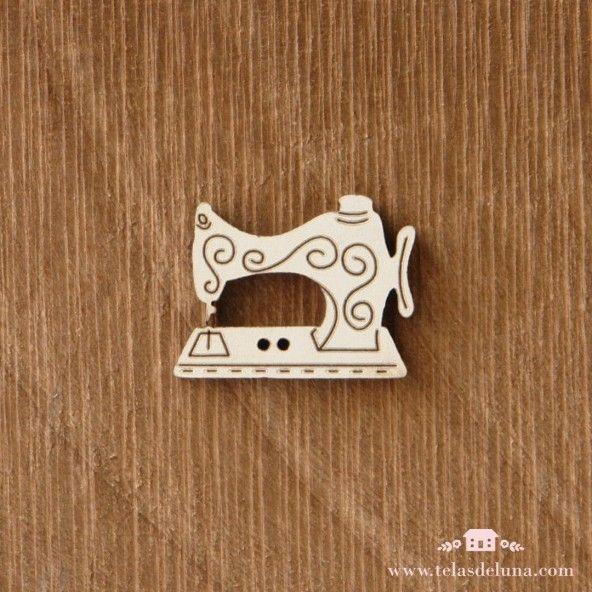 Botón blanco maquina de coser