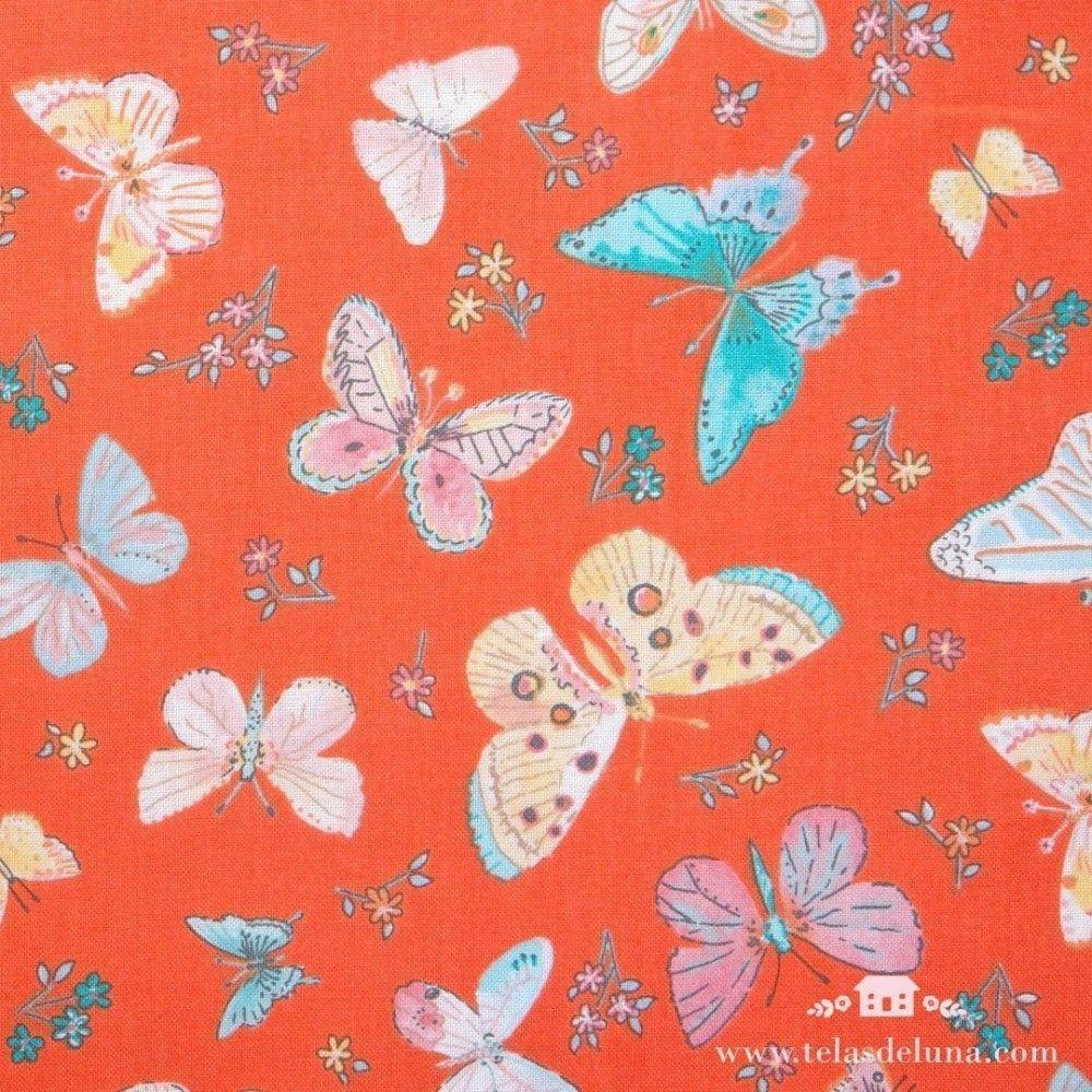 Tela mariposas con flores