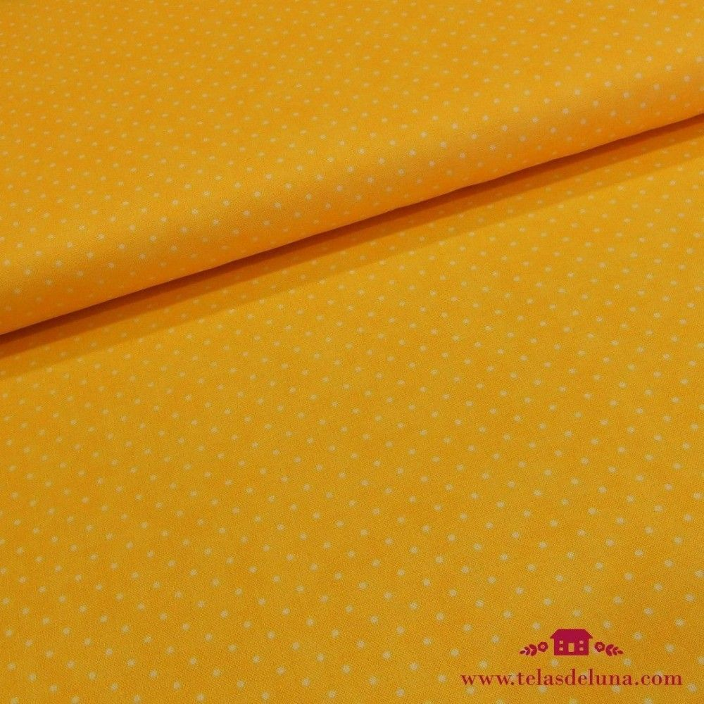 Tela topos blancos sobre fondo amarillo