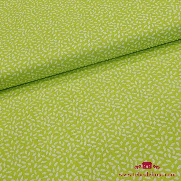 Tela verde pistacho semillas blancas