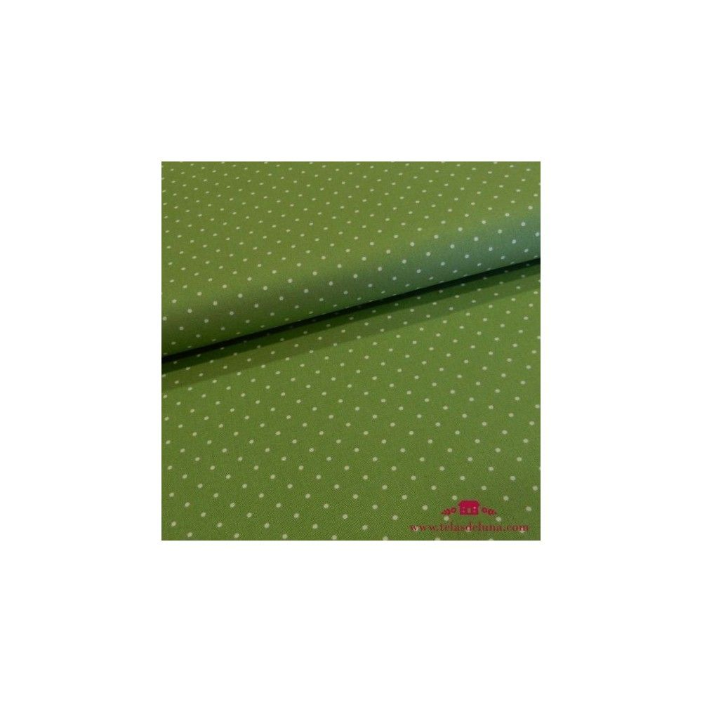 Tela verde con topos blancos