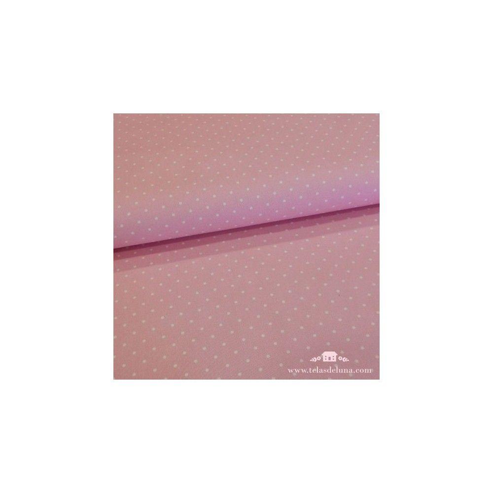 Tela rosa claro con topos blancos
