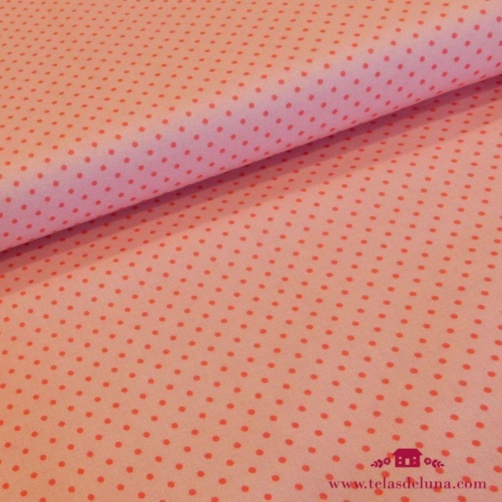 Tela rosa con topos