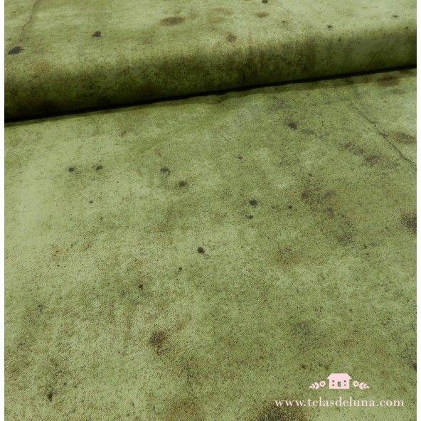 Tela verde con manchas