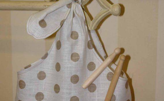 bolsa blanca con topos marrones para guardar las pinzas